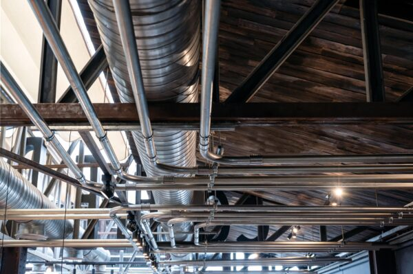 ceiling-structure-with-steel-ventilation-pipe-and-shiny-pipe-systems-min